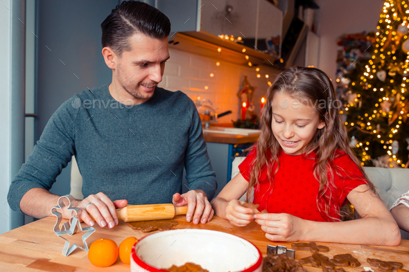 Family baking gingerbread cookies on Xmas vacation - Stock Photo - Images