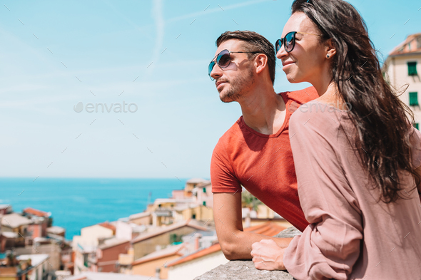 Tourists looking at scenic view of Riomaggiore, Cinque Terre, Liguria, Italy - Stock Photo - Images