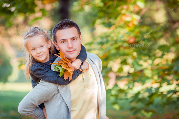 Family of dad and kid on beautiful autumn day in the park - Stock Photo - Images