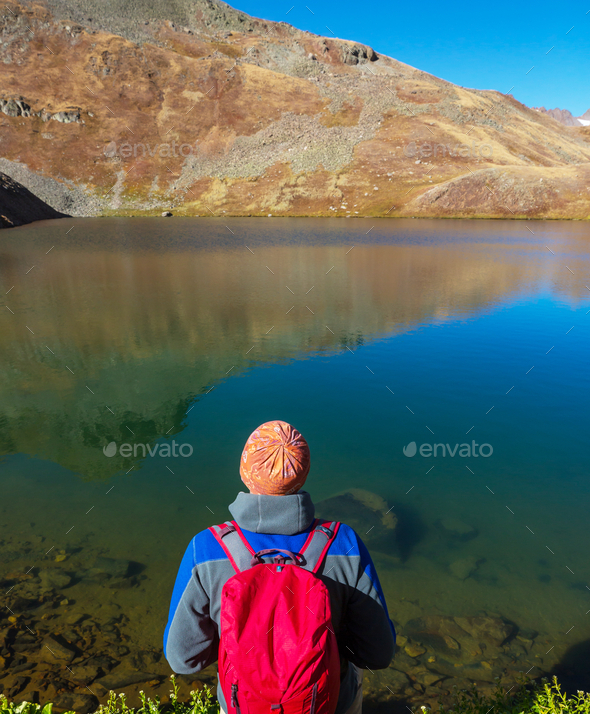 Relaxing on mountain lake - Stock Photo - Images