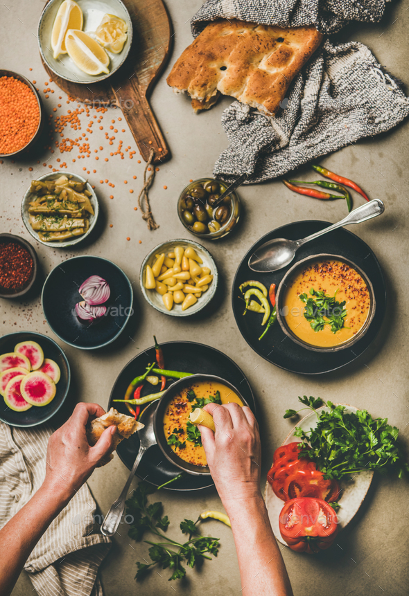 Turkish traditional lentil soup Mercimek and hands adding lemon juice - Stock Photo - Images
