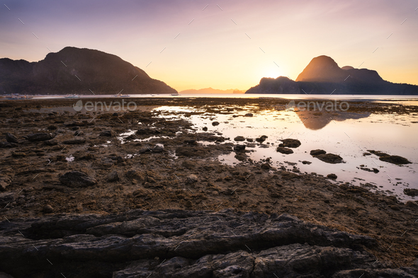 Sunset on El Nido village with silhouette of tropical islands in background. Palawan, Philippines - Stock Photo - Images