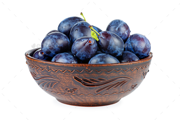 Blue plums in ceramic bowl - Stock Photo - Images