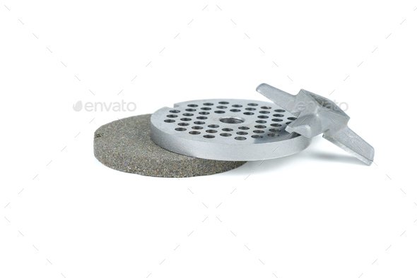 Meat grinder grate, knife and sharpening stone - Stock Photo - Images