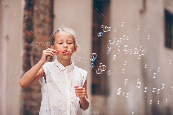 Adorable fashion little girl outdoors in European city Rome - Stock Photo - Images