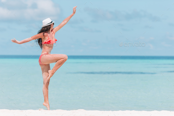 Beautiful woman relaxing at white sand tropical beach - Stock Photo - Images