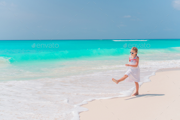 Portrait of adorable little girl at beach on her summer vacation - Stock Photo - Images