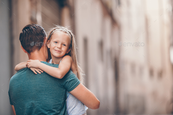 Happy dad and little adorable girl traveling in Rome, Italy - Stock Photo - Images