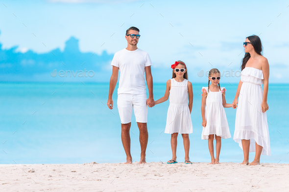 Happy beautiful family with kids on the beach - Stock Photo - Images