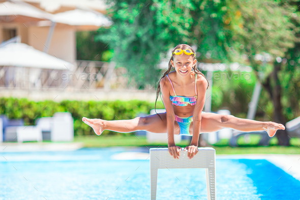 Little sporty girl having fun in outdoor swimming pool - Stock Photo - Images