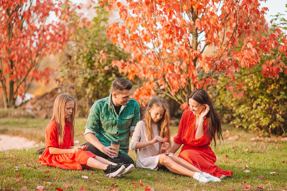 Portrait of happy family of four in autumn - Stock Photo - Images