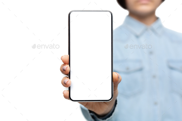 Smartphone with blank screen in hands of unrecognizable woman - Stock Photo - Images