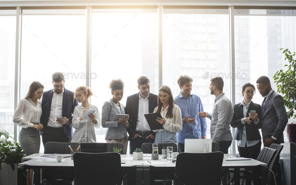Diverse business team discussing work during break - Stock Photo - Images