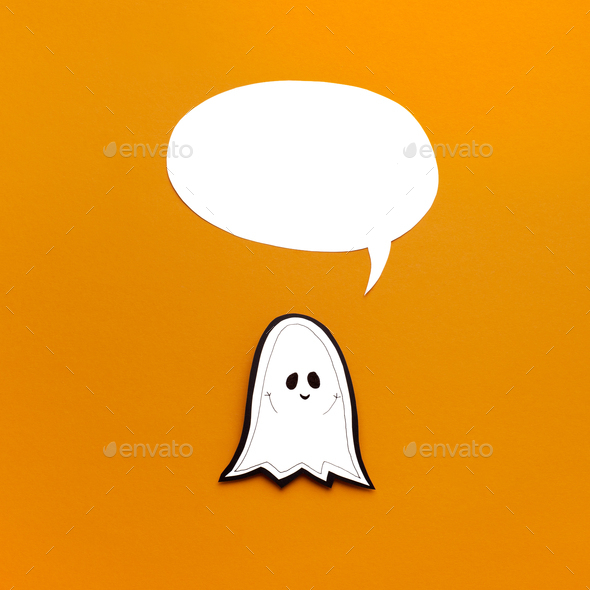 Smiling paper ghost with empty speech bubble for tag - Stock Photo - Images