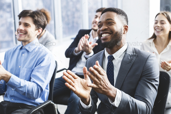 Happy businessmen applauding good presentation in office - Stock Photo - Images