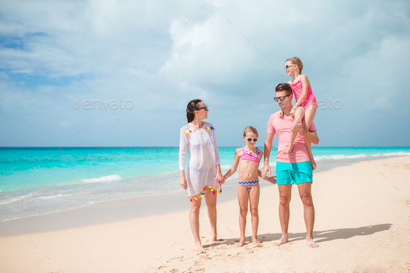 Young family on vacation on the beach - Stock Photo - Images