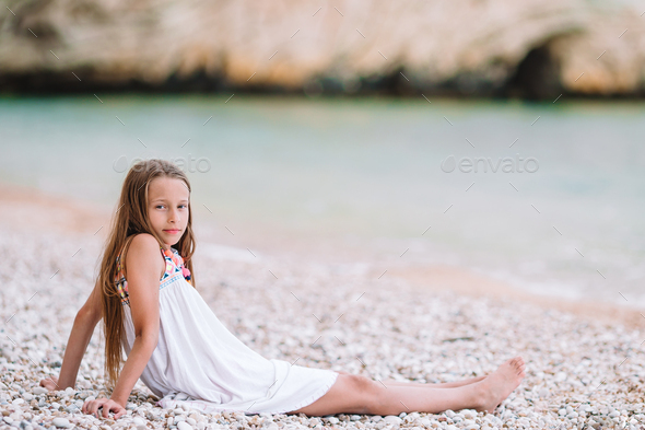 Cute little girl at beach during summer vacation - Stock Photo - Images