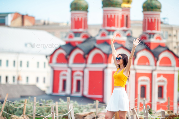 Happy young urban woman in european city - Stock Photo - Images
