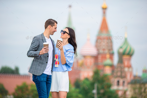 Young dating couple in love walking in city background St Basils Church - Stock Photo - Images