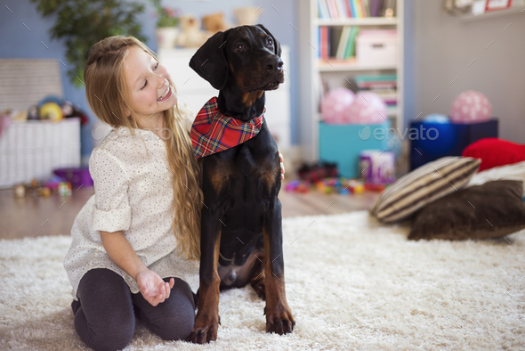 This doberman is her best friend - Stock Photo - Images