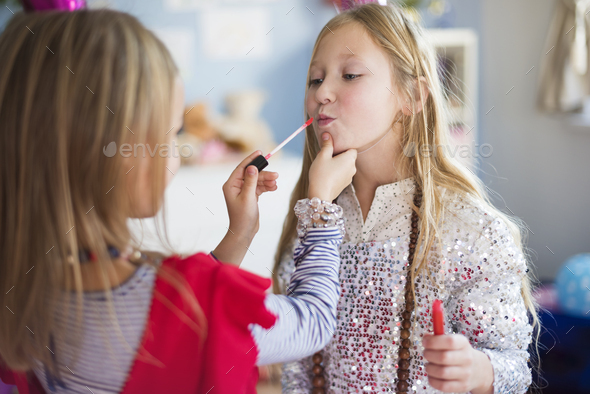 One sister helping another with doing make up - Stock Photo - Images