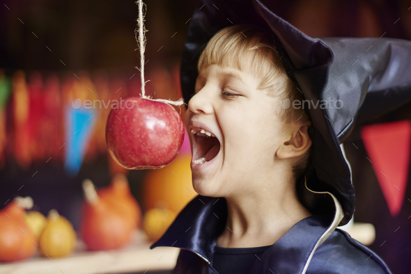 Can you bite it without touching? - Stock Photo - Images