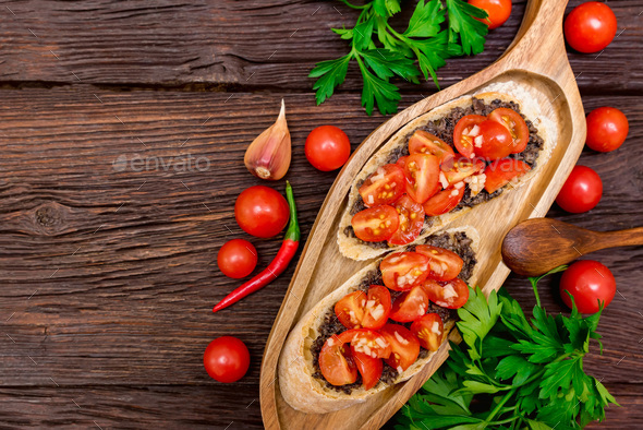 Fresh tasty bruschetta with truffle sauce, parsley and tomates. Top view - Stock Photo - Images