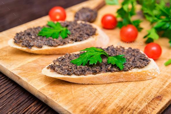 Fresh tasty bruschetta with truffle sauce, parsley and tomates - Stock Photo - Images