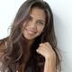 Beautiful woman with dark flowing hair looking at camera - PhotoDune Item for Sale