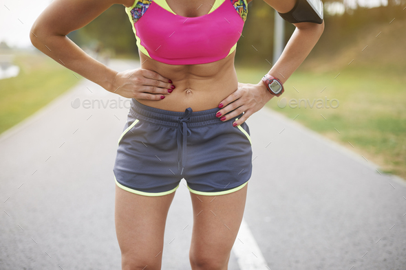 Colic is a frequent problem while jogging - Stock Photo - Images