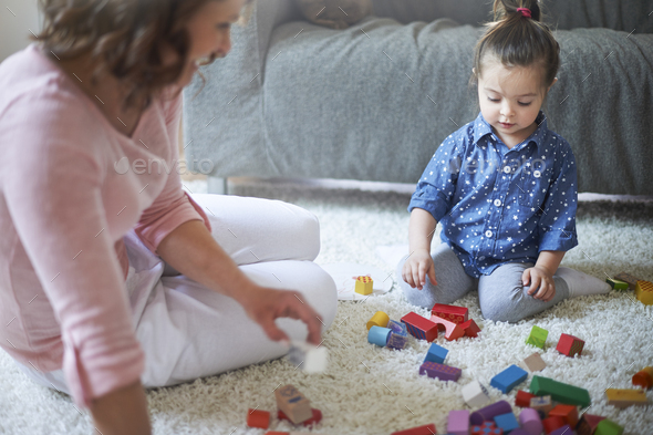 Building towers from blocks teaches imagination - Stock Photo - Images
