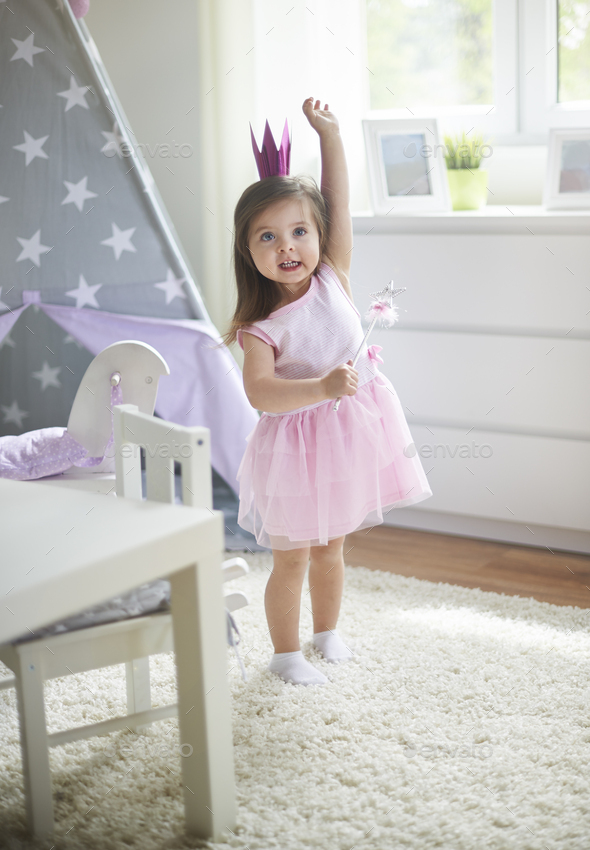 Little cute fairy with magic wand - Stock Photo - Images