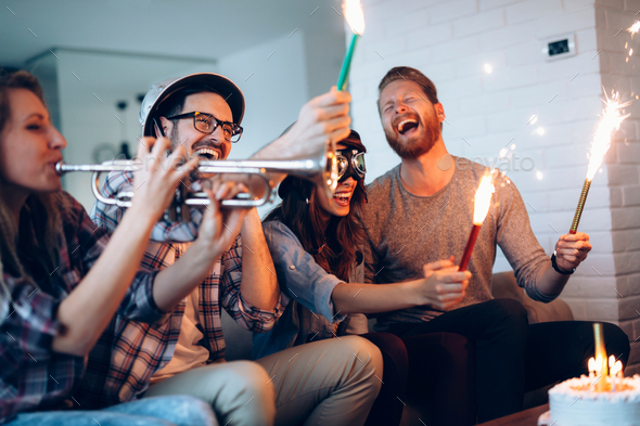 Group of friends celebrating birthday together at home - Stock Photo - Images