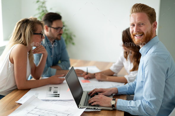 Business people working as a team at the office - Stock Photo - Images