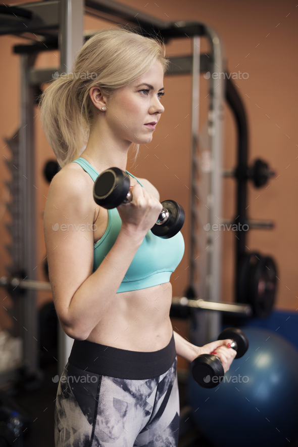 Side view of woman during workout - Stock Photo - Images