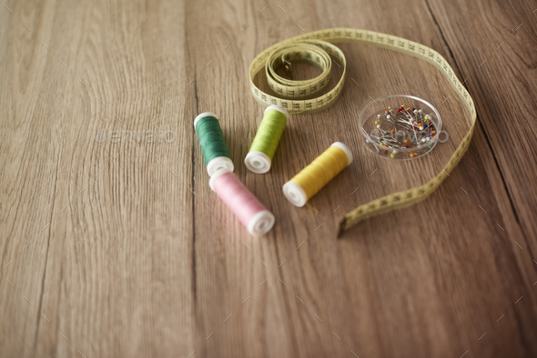 Sewing accessories on wooden table - Stock Photo - Images