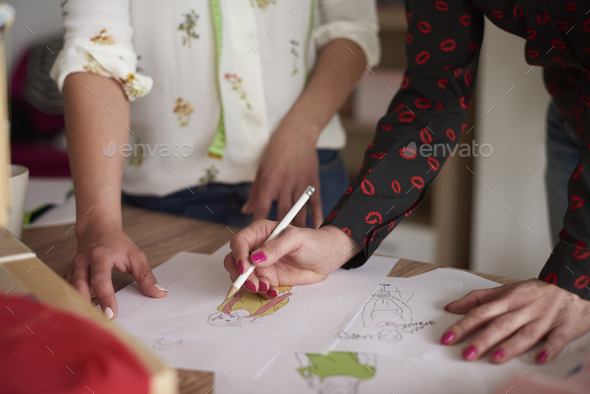 Women making sketches of clothes - Stock Photo - Images