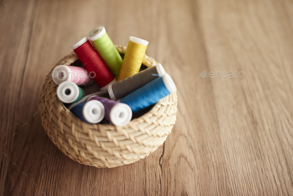 Colorful thread spools in the basket - Stock Photo - Images