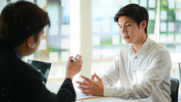 Interviewing job seekers presenting their resume for executives to consider. - Stock Photo - Images