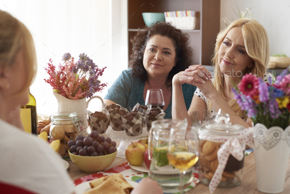 Gossips with friends over dinner - Stock Photo - Images