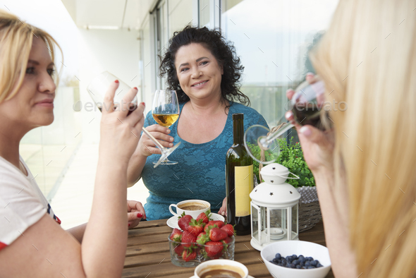 Mature woman drinking wine - Stock Photo - Images
