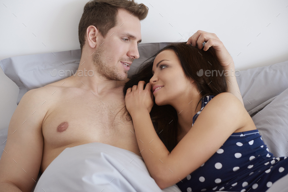 Talking in bed in the morning - Stock Photo - Images