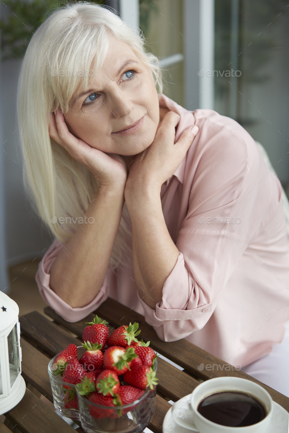 Thoughtful grandmother at the balcony - Stock Photo - Images