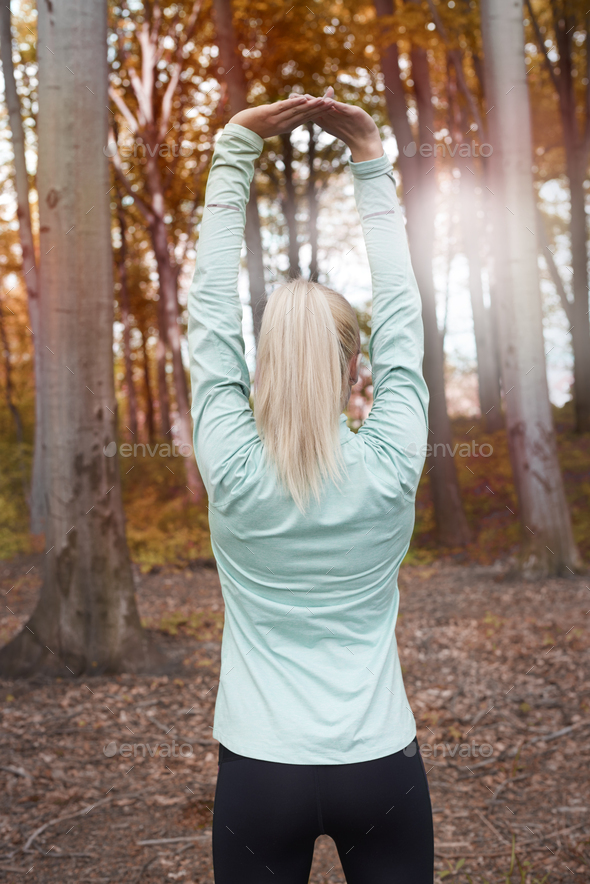 Rear view of stretching woman - Stock Photo - Images