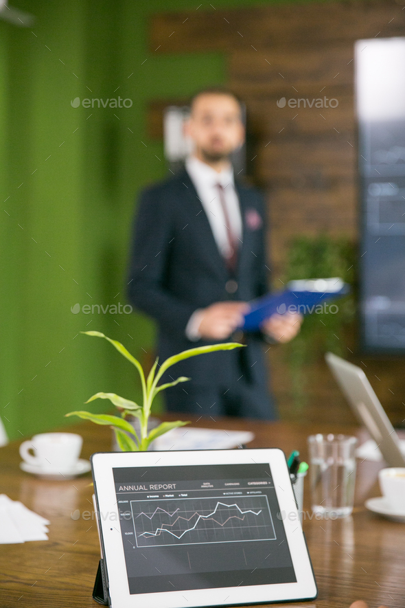 Close up of tablet with charts in the conference room - Stock Photo - Images