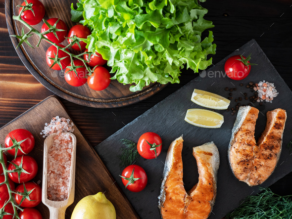 Top view of salmon and tomato arrangement on plates - Stock Photo - Images