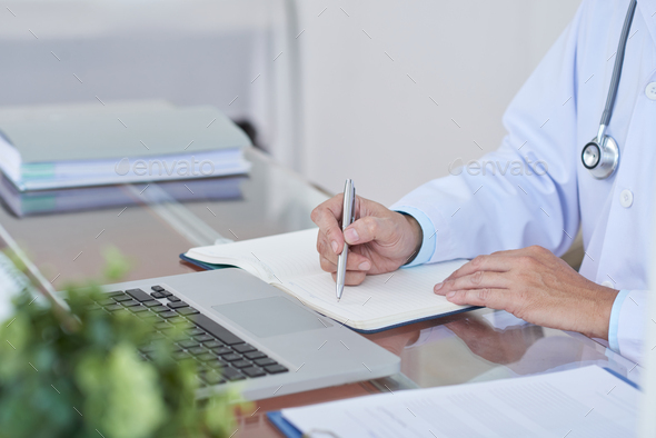 Doctor working at the table - Stock Photo - Images