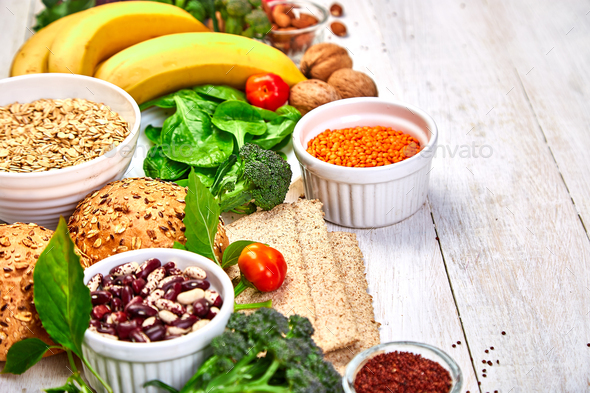 Selection food rich in fiber on white wooden background. - Stock Photo - Images