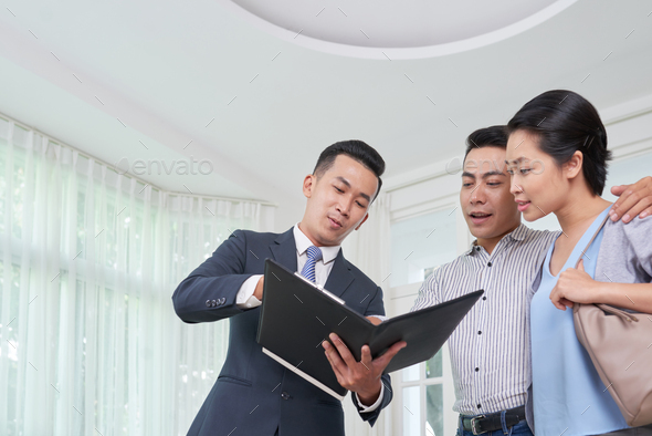 Broker explaining contract details - Stock Photo - Images
