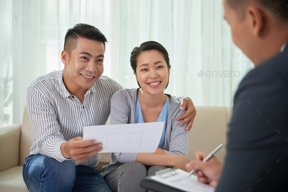 Asian couple meeting with broker - Stock Photo - Images
